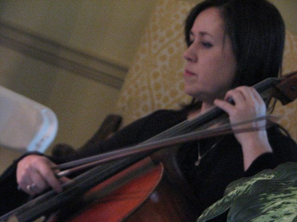 Anna plays cello in the String Quartet and sings.