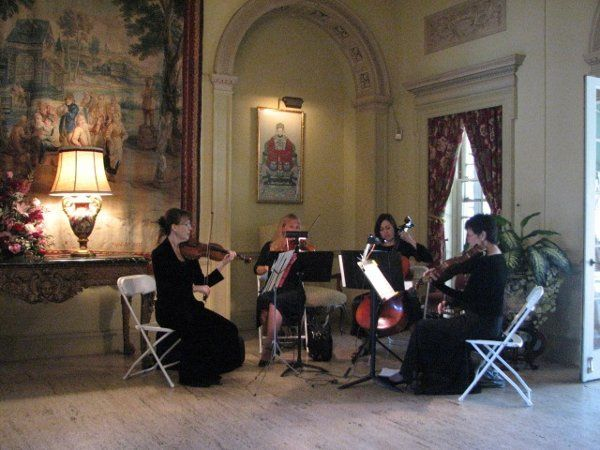 The Victorian String Quartet playing in the foyer at the Phipps Mansion, Denver, Colorado.