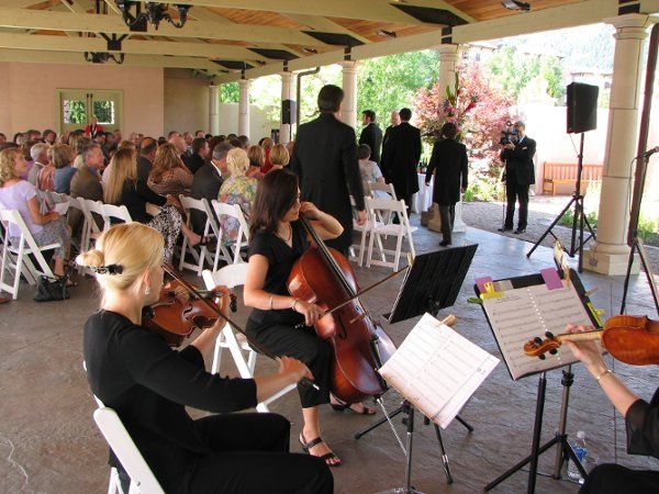 The Leavitt Music Service string quartet plays a wedding ceremony at the Broadmoor Hotel in Colorado...