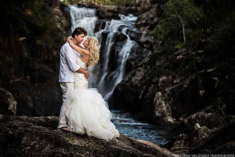 Couple by a waterfall on the day after the wedding