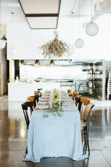 Open kitchen and beautiful tablescapesPhoto: Love Lit Wedding Photography