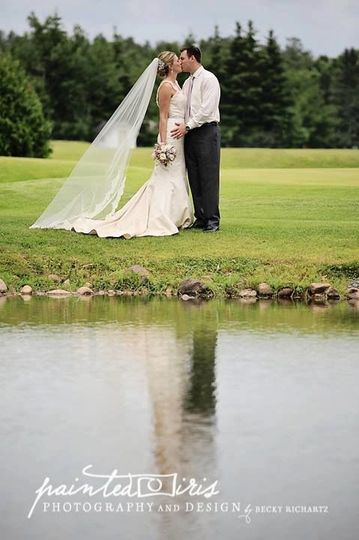 Wedding kiss by the lake