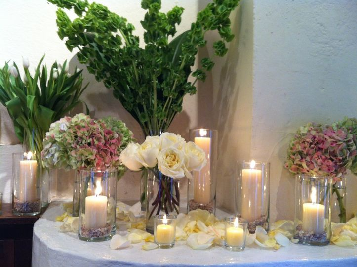 Table with candles and floral decors