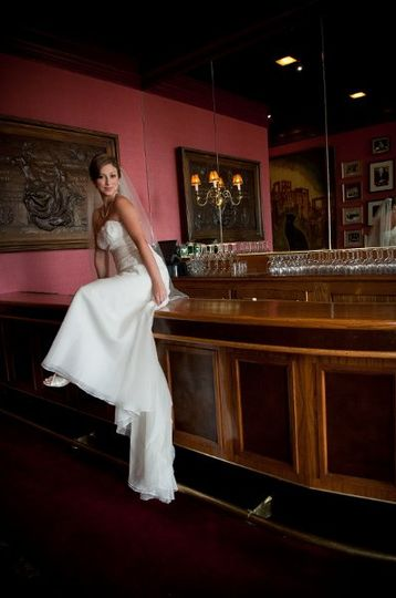 Bride sitting on the bar