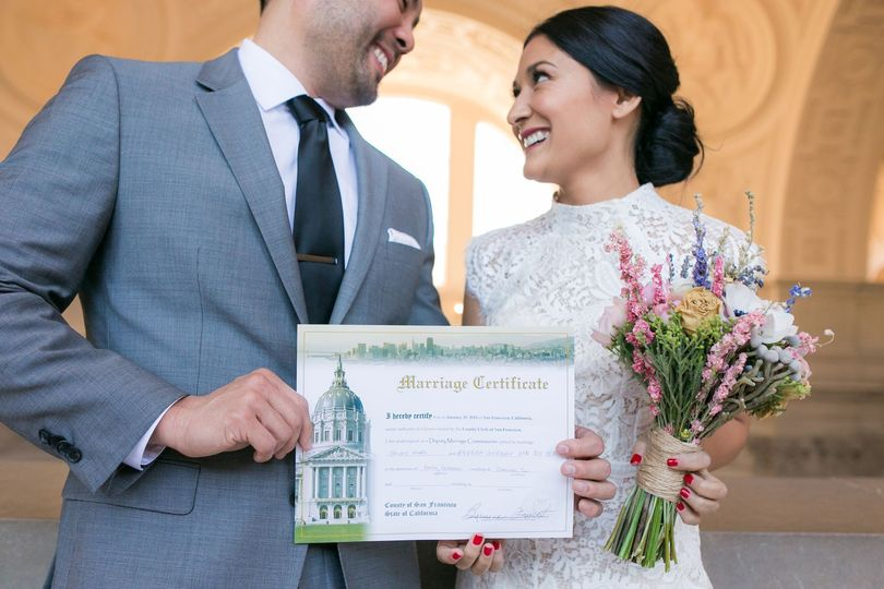 Bride and groom holding their certificate