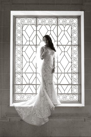 Bride standing by the window