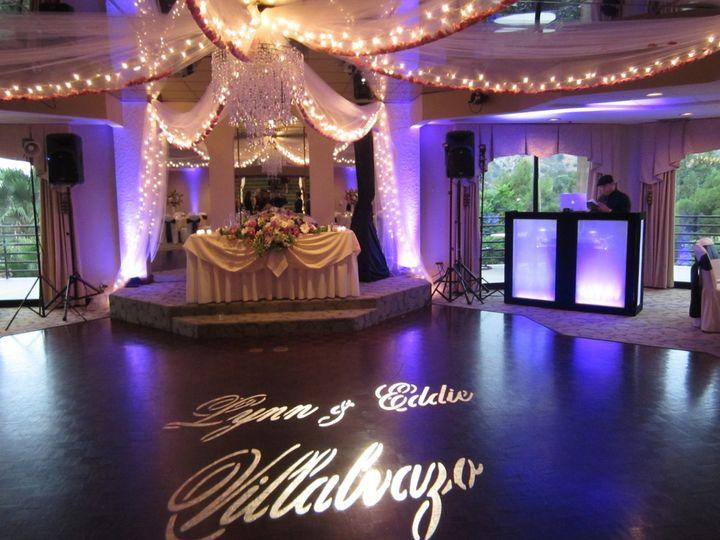 "Purple LED Uplighting, Custom ""Name in lights"" Gobo, & DJ glow booth also with purple LED lighting!"