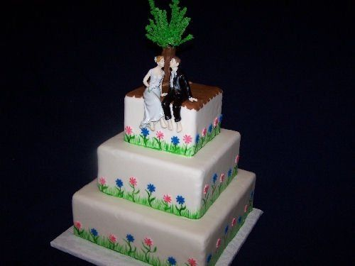 Hand painted grass and leaves on white fondant with fondant tree, flowers and deck.