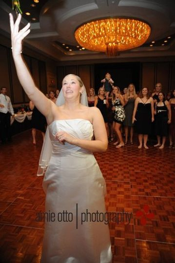Bride toasting her bouquet