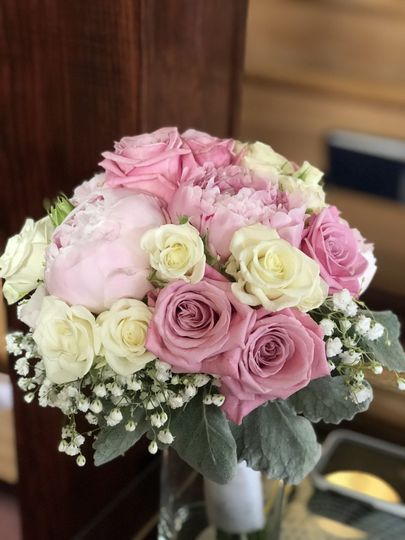 Peonies, roses, baby breath, and dusty miller bouquet