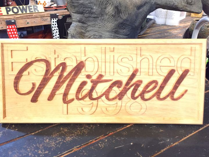 "Another example of an embossed sign with last name over ""established (year)"". . . many stain colors..."