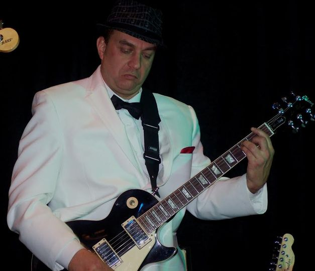 Greg on guitar