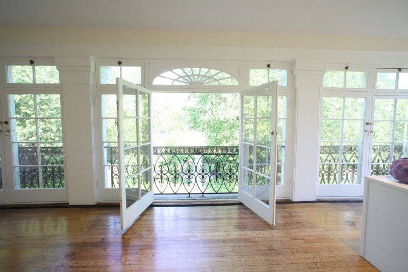 Side doors on the second floor Gallery Porch overlook the ceremony area, the formal gardens and the...