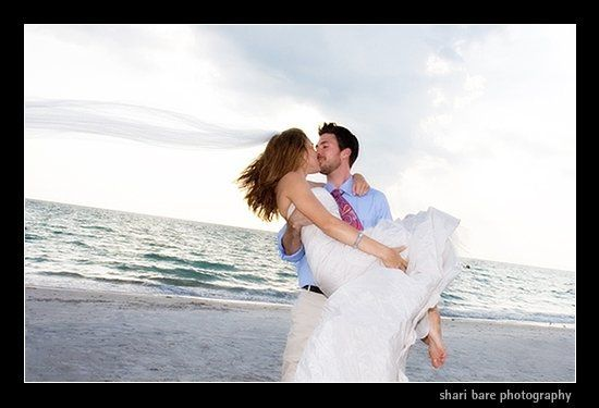 Bride and groom on the beach in Naples, Florida