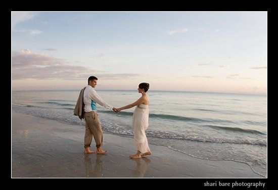 Bride and groom on the beach in Naples, Florida at the Ritz Carlton Beach Hotel