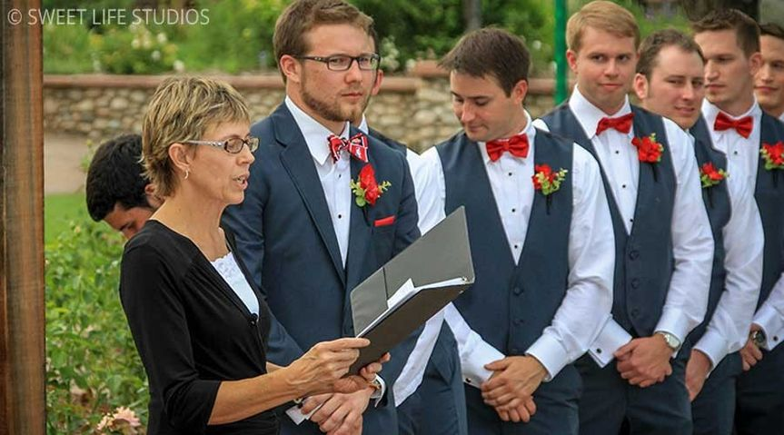 Groom and groomsmen with the officiant