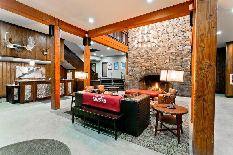 Killington Mountain Lodge front lobby with cozy fieldstone fireplace.