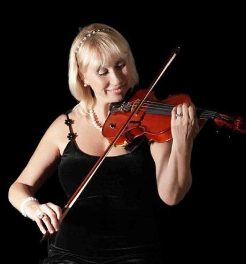 Live violin music at a wedding is poetry to the soul and makes your event memorial