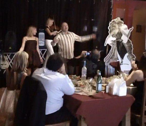 Tatiana plays on stage at wedding reception