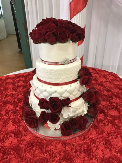 Four tier cake with rose decoration