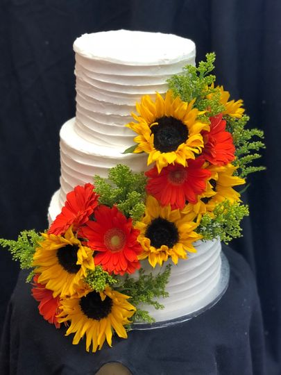 Sunflower and daisy decorated cake