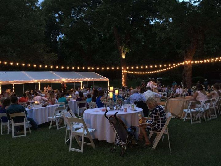 Beautiful, outdoor reception space under canopy of trees...and unusually cool for West Tx.