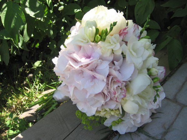 classic summer bridal bouquet -- hydrangea, peonies, freesia and garden roses
