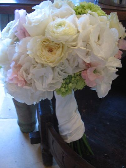 classic bridal bouquet with hydrangea, pale pink sweet pea, ranunculus, cream garden roses and mini...