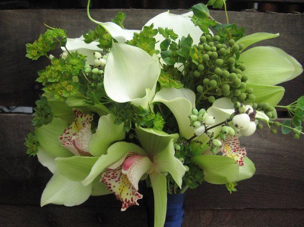 white calla lilies, chartreuse cymbidium blooms, snowberry and Brazillia berries