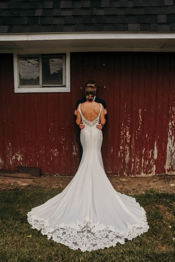 Couple posing near barn
