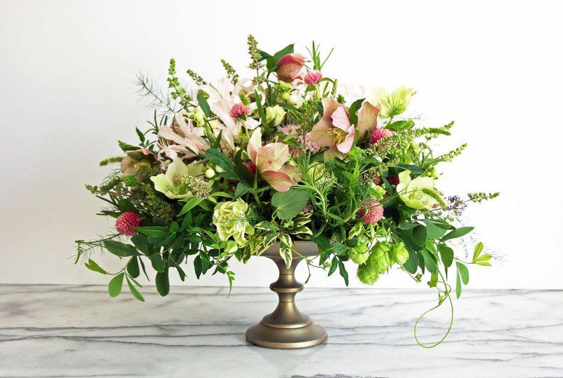 Elegant, vintage-style arrangement of hellebore and wildflowers.