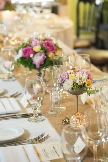 Pink and gold  arrangements were the perfect balance to the rough linen runner.