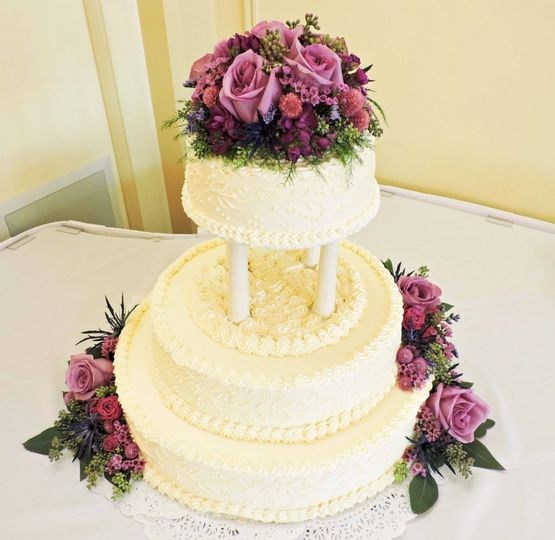 Beautiful flowers to accent a lovely tiered cake. ( We think it was Red Velvet! )