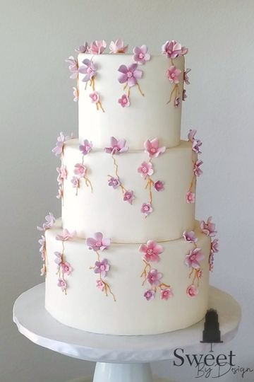 Pink and purple fondant wedding cake by sweet by design in melissa, tx