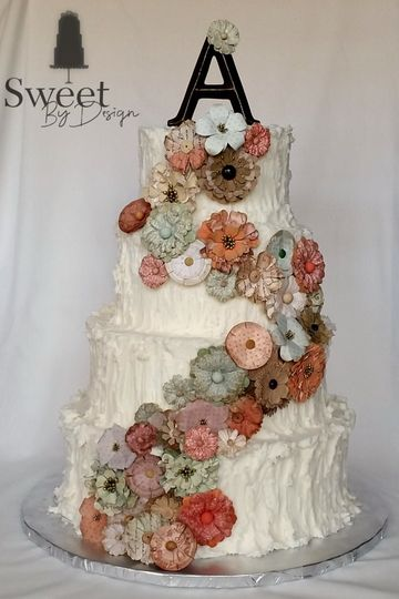 Rustic buttercream wedding cake with paper flowers by sweet by design in melissa, tx