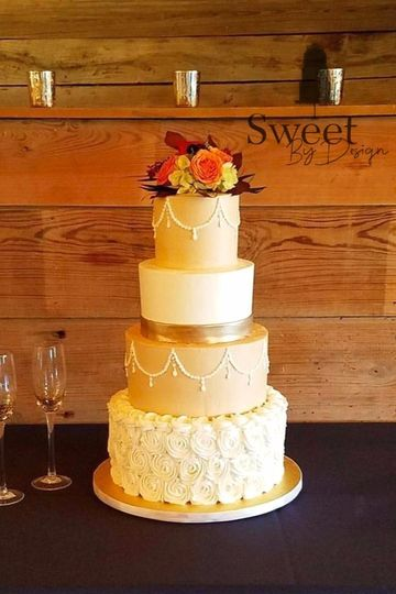 Buttercream rosette wedding cake with piped pearl swag.