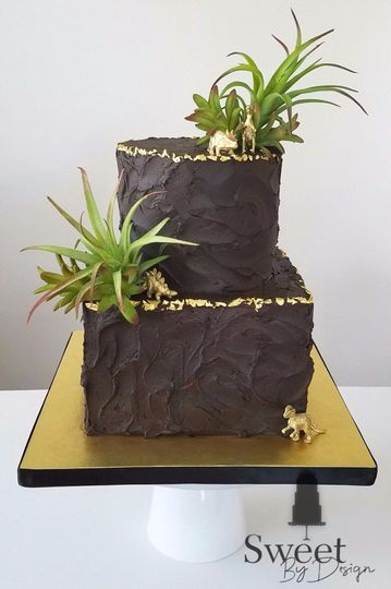 Chocolate dinosaur groom's cake with edible gold leaf by sweet by design in melissa, tx