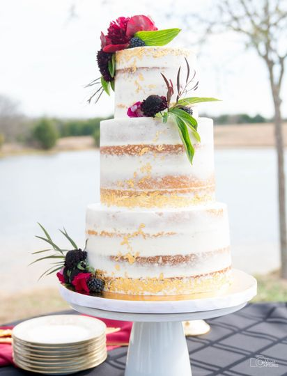 Naked cake with edible gold leaf by sweet by design in melissa, tx