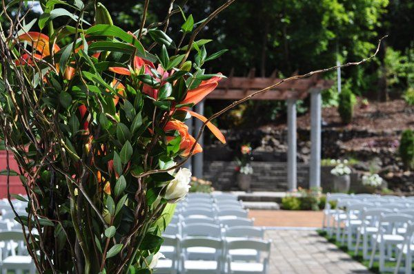 The beautiful side yard set up for an out-door wedding ceremony. At this wedding, during the...