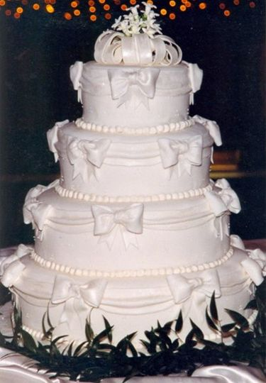 Drapes and Bows fondant Wedding Cake with Handmade Sugar Flowers