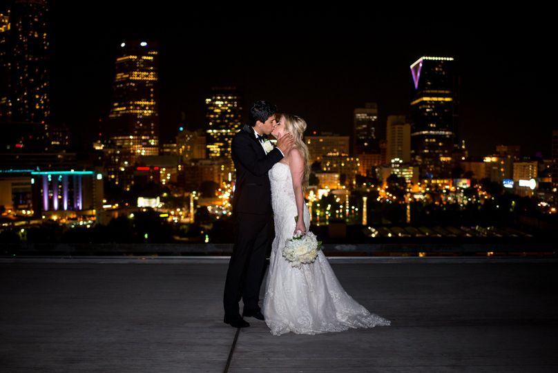 Couple kiss against a cityscape