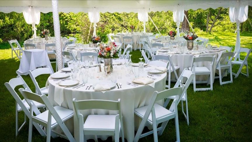 5 5 round tables floor length linens resin chairs