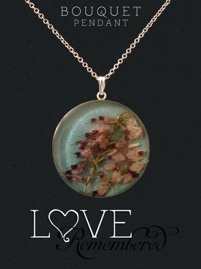 This beautiful sterling silver pendant was created using ribbon from the wedding, as well as heather...