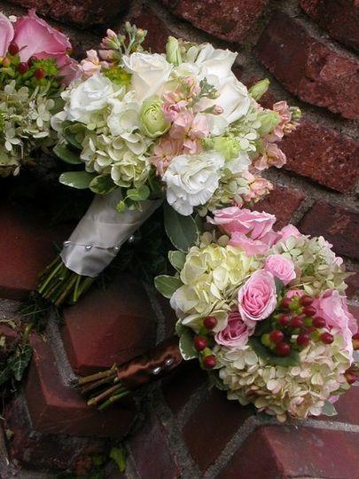 soft combination of stock, hydrangea,garden spray roses,hypericum berries and lysianthus