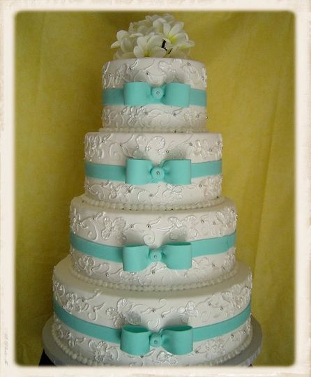 The blue bows match the theme of the wedding with filler design to match the wedding dress