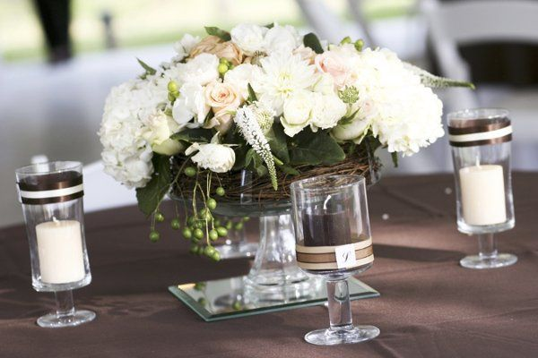 Romantic garden inspired table centerpiece with antique roses, dahlias, berries, grapevine and...