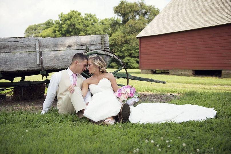 Couple photo by a wheelbarrow