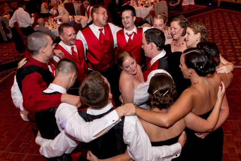 Bridesmaids and groomsmen around the newlyweds