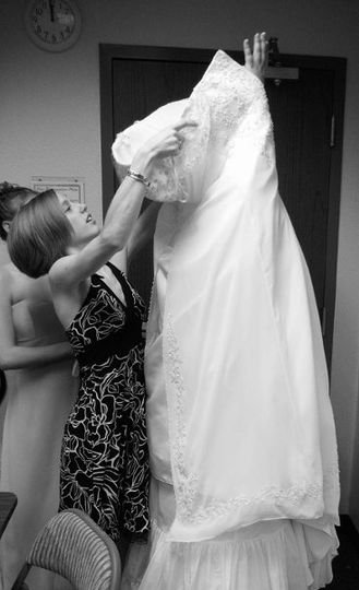 Dressing the bride! Photography by Arizona Wedding Photos