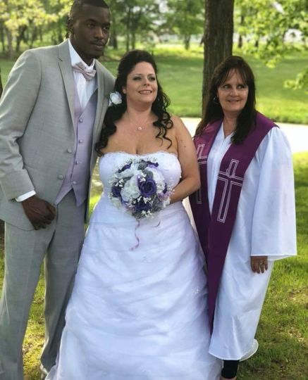 The couple with the officiant